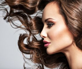 Beautiful woman with long brown curly hair Stock Photo 01