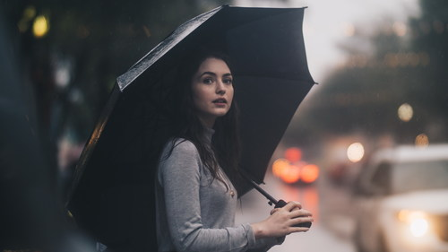 Beauty hold up an umbrella on rainy days Stock Photo