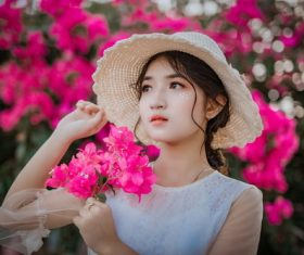 Cheerful bright makeup girl holding flowers Stock Photo