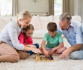 Family playing Chess Stock Photo
