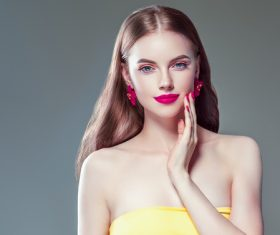Fashionable bright makeup girl wearing flower earrings Stock Photo 06