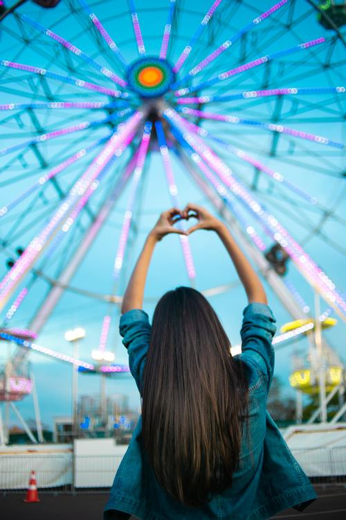 Ferris wheel long hair beauty back shadow Stock Photo