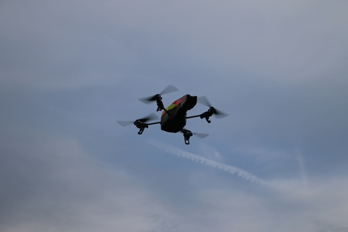 Four axis remote drone in the air Stock Photo 01