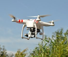 Four-axis remote drone in the air Stock Photo 02