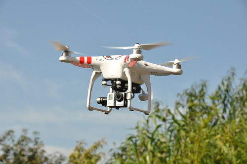 Four axis remote drone in the air Stock Photo 02
