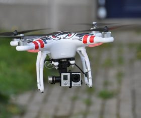 Four-axis remote drone in the air Stock Photo 03