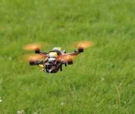 Four-axis remote drone in the air Stock Photo 04