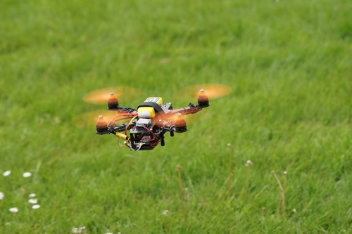 Four axis remote drone in the air Stock Photo 04