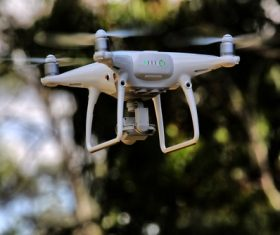 Four-axis remote drone in the air Stock Photo 05