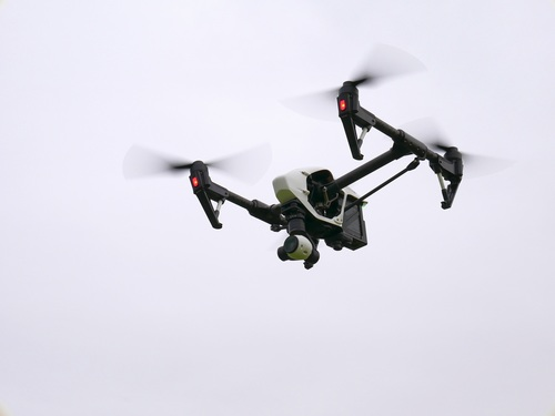 Four axis remote drone in the air Stock Photo 06