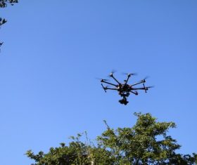 Four-axis remote drone in the air Stock Photo 07