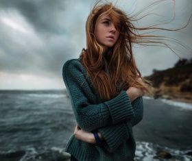 Girl blowing the sea breeze Stock Photo