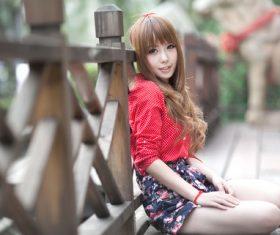 Girl sitting on the wooden bridge posing Stock Photo