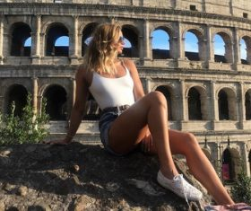 Girl taking pictures next to ancient Roman ruins Stock Photo