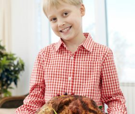 Little boy and festive sultry turkey Stock Photo