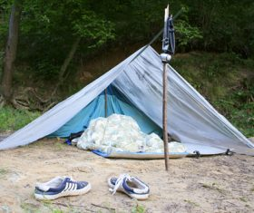 Man sleeping in camping tent Stock Photo