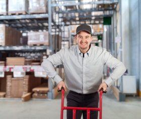 Man working in logistics warehouse Stock Photo
