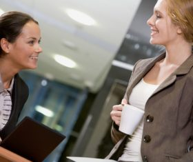 Office ladies drinking coffee work Stock Photo 02