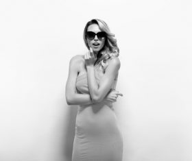 Posing woman wearing sunglasses in studio shooting Stock Photo 01