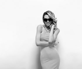 Posing woman wearing sunglasses in studio shooting Stock Photo 02