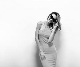 Posing woman wearing sunglasses in studio shooting Stock Photo 03