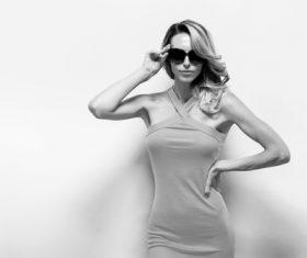 Posing woman wearing sunglasses in studio shooting Stock Photo 09