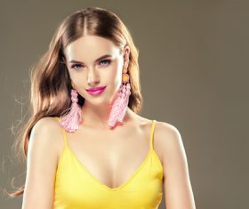 Pretty girl wearing handmade woven earrings Stock Photo 01