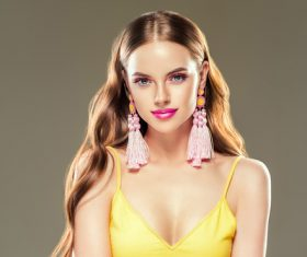 Pretty girl wearing handmade woven earrings Stock Photo 03