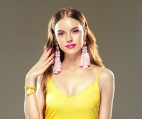 Pretty girl wearing handmade woven earrings Stock Photo 04