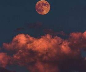 Reddish dusk moon Stock Photo