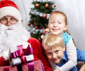 Santa Claus and cute children Stock Photo 02