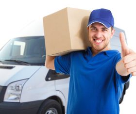 Smiling young delivery guy Stock Photo 01
