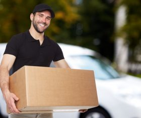 Smiling young delivery guy Stock Photo 02