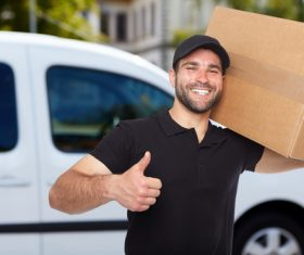 Smiling young delivery guy Stock Photo 03