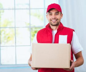 Smiling young delivery guy Stock Photo 04