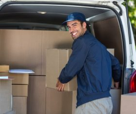 Smiling young delivery guy Stock Photo 05