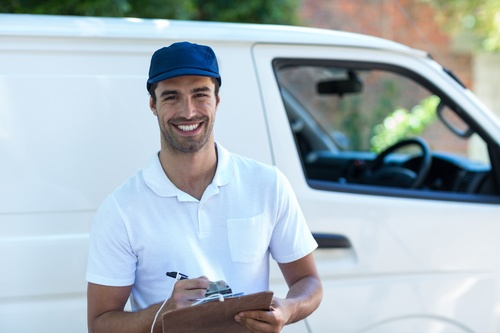 Smiling young delivery guy Stock Photo 06
