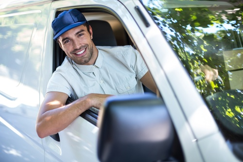 Smiling young delivery guy Stock Photo 07