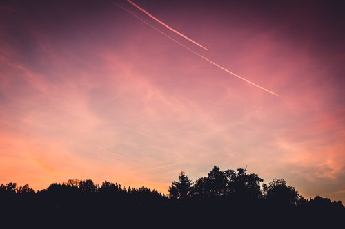 Stock Photo Airplane on the sky in dusk evening