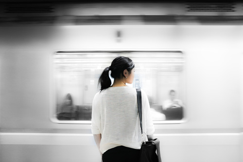 Stock Photo Asian girl waiting for the subway