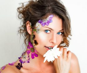 Stock Photo Beautiful woman decorated with petals
