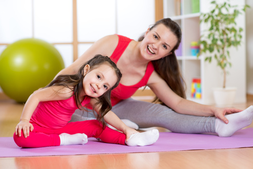 Stock Photo Children who exercise with their mother