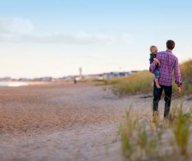 Stock Photo Father took walk with his child on the beach