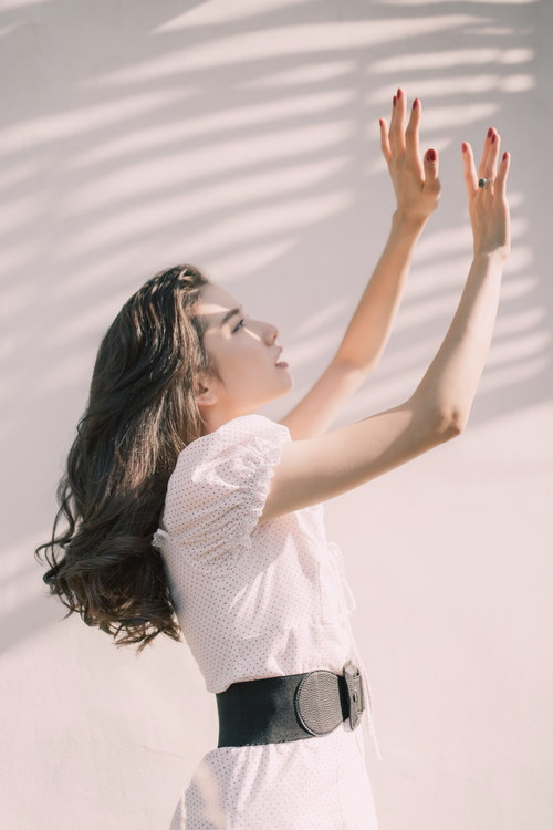 Stock Photo Girl covering the sun by hand