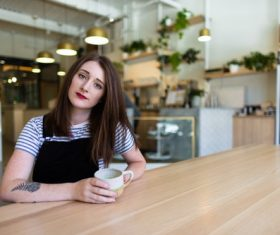 Stock Photo Girl drinking coffee in coffee shop