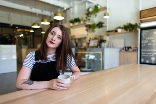 Stock Photo Girl drinking coffee in coffee shop