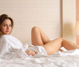 Stock Photo Girl in pajamas lying on the bed