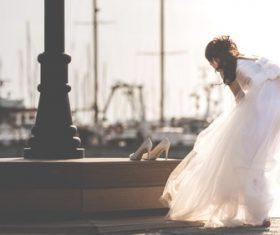 Stock Photo Girl preparing to take wedding photo