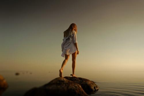 Stock Photo Girl walking on the reef