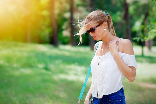 Stock Photo Girl wearing sunglasses walking in the park
